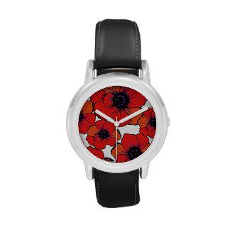 Flores anaranjadas rojas intrépidas relojes de mano