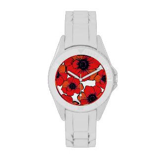 Flores anaranjadas rojas intrépidas reloj