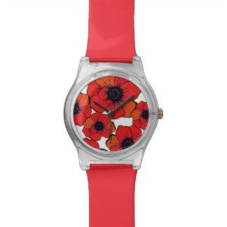 Flores anaranjadas rojas intrépidas relojes