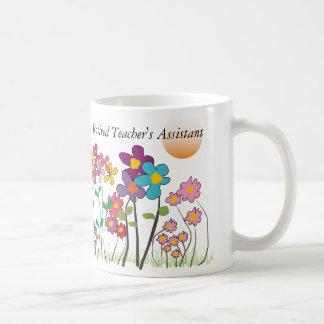 Flores artsy de la taza auxiliar del profesor