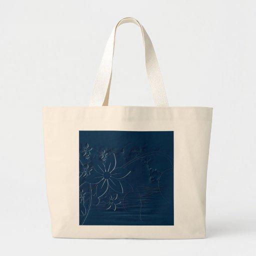 Flores azules en un fondo azul bolsas de mano