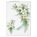 Flores blancas con la cinta tarjeta de felicitación
