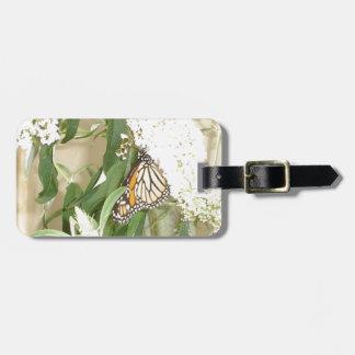 Flores blancas de la mariposa de la etiqueta del e etiqueta para maleta
