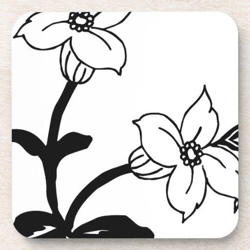 Flores blancos y negros posavasos de bebidas
