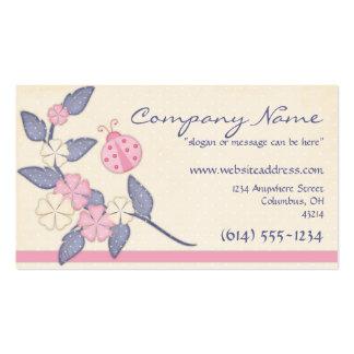 Flores bonitas con la tarjeta de visita rosada de