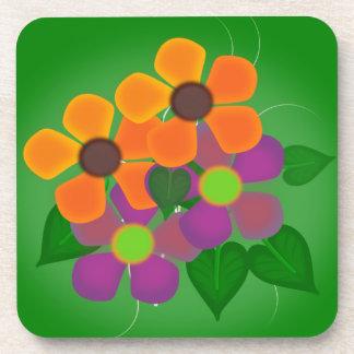 Flores bonitas de la primavera del naranja y de la posavaso