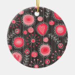 Flores caprichosas en rojo y gris adorno de navidad