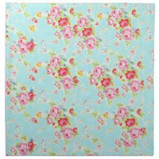 Flores color de rosa lamentables azules de los ros servilleta imprimida