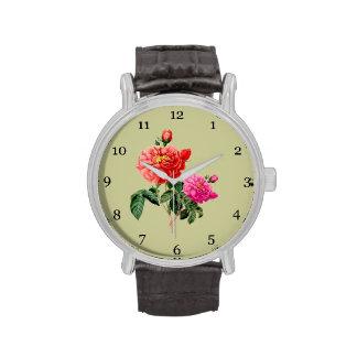 Flores color de rosa rojas y rosadas del arte relojes