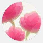 Flores coloreadas rosa etiqueta redonda