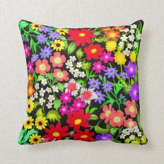 Flores coloridas del jardín cojin