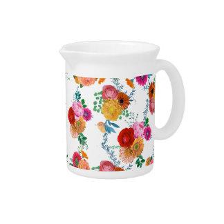 Flores coloridas románticas de la primavera de las jarra para bebida