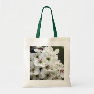 Flores de Apple en la bolsa de asas de la