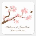 Flores de cerezo en el pegatina de la casilla