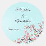 Flores de cerezo rosadas azules elegantes que casa