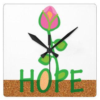 Flores de la esperanza de las semillas plantadas reloj cuadrado