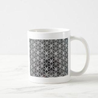 Flores de la estrella taza de café