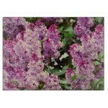 Flores de la lila tabla de cortar