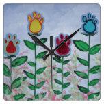 Flores de la pata reloj de pared