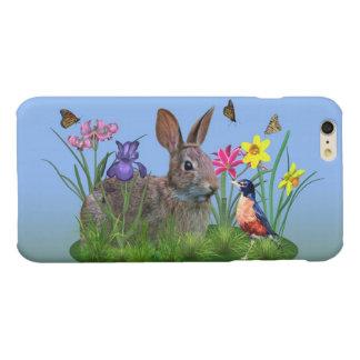 Flores de la primavera, petirrojo, y conejo de