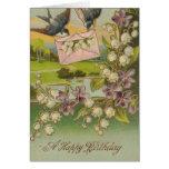 Flores de la púrpura de los pájaros del cumpleaños felicitaciones