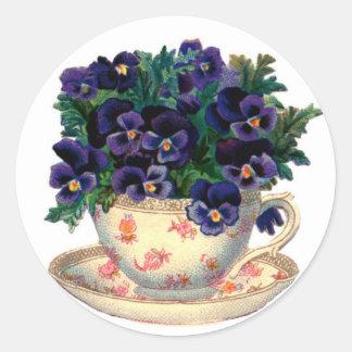 Flores de la taza de té pegatina redonda
