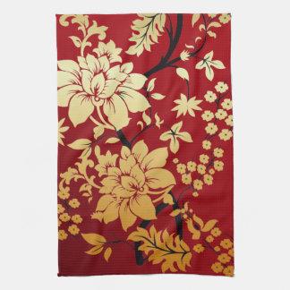 Flores de oro orientales en rojo toalla de cocina