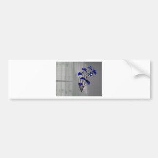 Flores de pared azules en fondo de la textura pegatina para auto