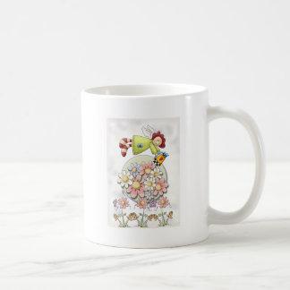 Flores de riego del ángel lindo del país taza de café