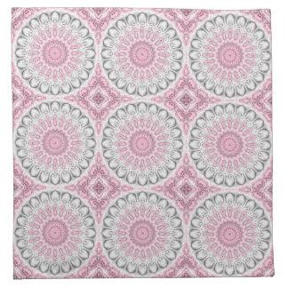 Flores del caleidoscopio en color de malva, rosa y servilletas imprimidas