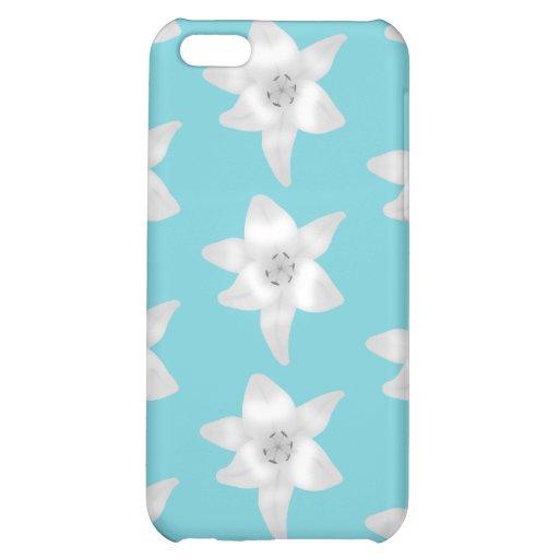 Flores del lirio blanco en un trullo - color de la