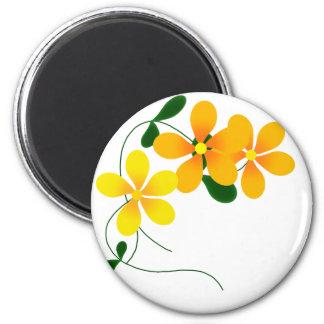 Flores del naranja y del amarillo imán redondo 5 cm