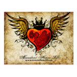 Flores del vintage y postal coa alas del tatuaje d