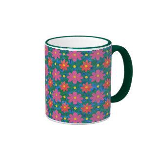 Flores elegantes de Rangoli, taza de café del