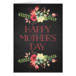 Flores en tarjeta del día de madre de la pizarra d