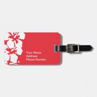 Flores hawaianas del hibisco en etiqueta roja del  etiquetas maletas