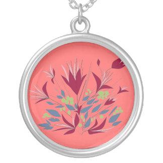 Flores magentas, en de color rosa oscuro. colgante redondo