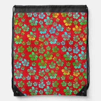Flores multicoloras del hibisco en rojo mochilas