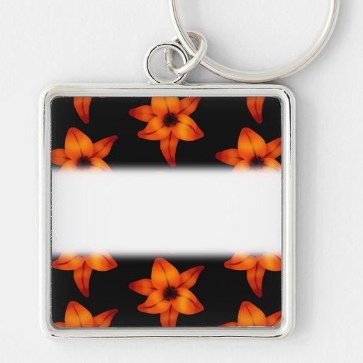 Flores naranja-rojas del lirio en negro llavero personalizado
