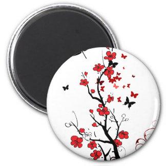 Flores negras y rojas imán redondo 5 cm