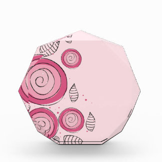 Flores que remolinan rosadas enrrolladas