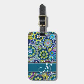 Flores retras coloridas con el monograma etiquetas para maletas