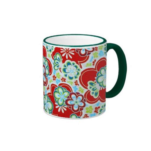 Flores rojas, azules, verdes y blancas tazas de café
