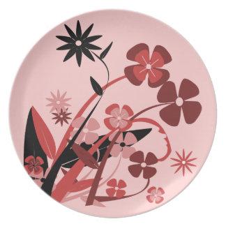 Flores rojas de baile plato