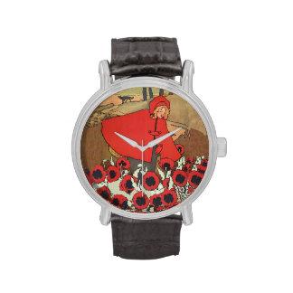 Flores rojas de la amapola del lobo de la capa con relojes de pulsera