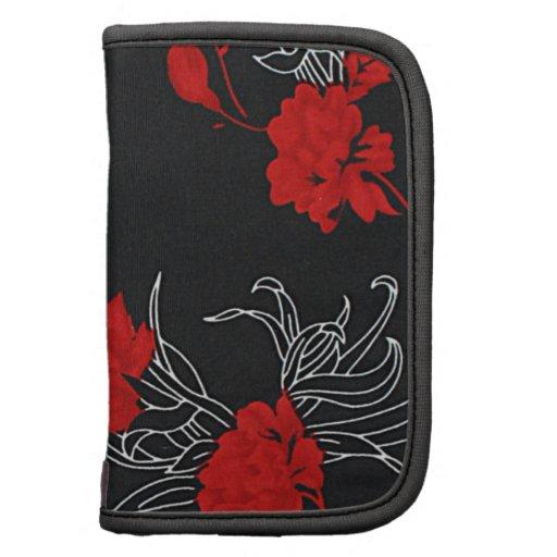 Flores rojas dramáticas en negro organizador