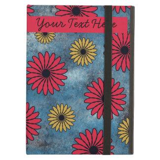 Flores rojas y amarillas en la caja azul del iPad