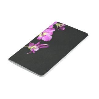 Flores rosadas de la orquídea cuaderno