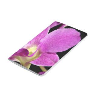 Flores rosadas de la orquídea cuaderno grapado