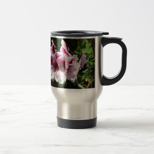 Flores rosadas del Pelargonium Taza Térmica